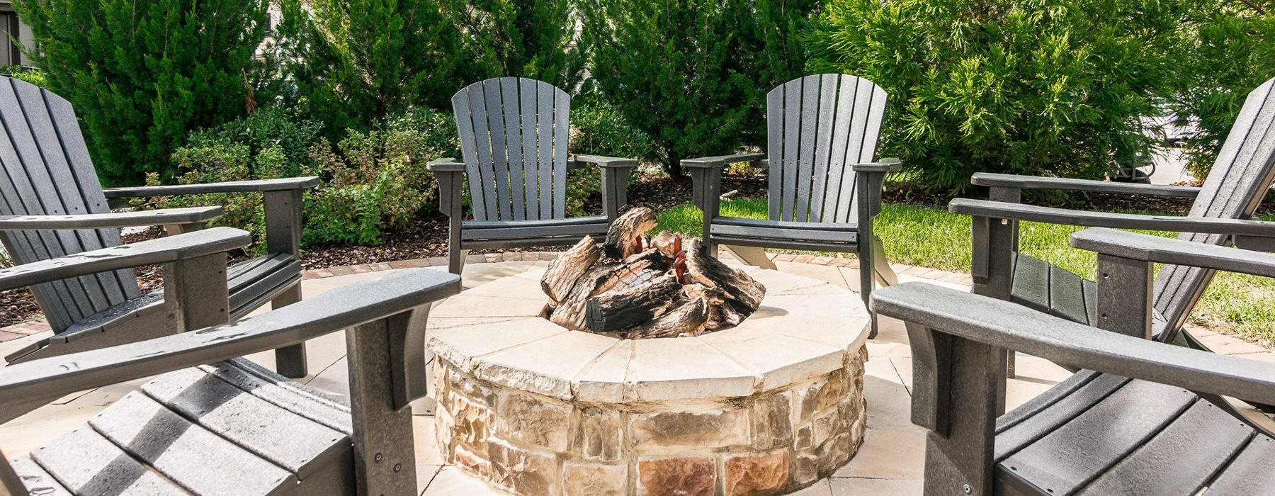 Firepits near the sparkling pool with ample seating